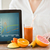 close up of woman hands with tablet pc and fruits stock photo © dolgachov