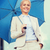 young smiling businesswoman with umbrella outdoors stock photo © dolgachov