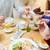 barátok · ebéd · együtt · otthon · étel · nők - stock fotó © dolgachov