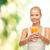 smiling woman holding glass of orange juice stock photo © dolgachov