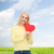 smiling woman with red heart stock photo © dolgachov