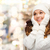 smiling young woman in white winter clothes stock photo © dolgachov