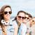 tienermeisje · hoofdtelefoon · vrienden · buiten · zomer · vakantie - stockfoto © dolgachov