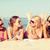 gruppo · sorridere · donne · occhiali · da · sole · spiaggia - foto d'archivio © dolgachov