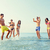 группа · счастливым · друзей · океана · пляж - Сток-фото © dolgachov
