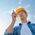builder in hardhat with walkie talkie stock photo © dolgachov