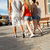 close up of teenage friends walking in city stock photo © dolgachov