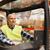smiling man operating forklift loader at warehouse stock photo © dolgachov