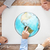 close up of hands with globe picture at table stock photo © dolgachov