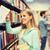 молодые · улыбающаяся · женщина · книга · библиотека · шельфа - Сток-фото © dolgachov