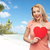 happy woman or teen girl with red heart shape stock photo © dolgachov