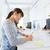 architect woman drawing on blueprint at office stock photo © dolgachov