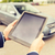 close up of young man with tablet pc and car foto stock © dolgachov