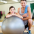 two smiling people with fitness ball stock photo © dolgachov
