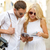 couple with map camera and travellers guide stock photo © dolgachov