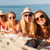 group of smiling young women with tablets on beach stock photo © dolgachov