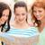 smiling teenage girls with map and camera stock photo © dolgachov