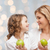 happy mother and daughter with green apples stock photo © dolgachov