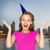 happy young woman or teen girl in party cap stock photo © dolgachov