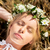happy woman in wreath of flowers lying on straw stock photo © dolgachov