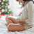 close up of pregnant woman in bed at christmas stock photo © dolgachov