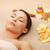 woman in spa salon lying on the massage desk stock photo © dolgachov