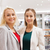 happy young women in mall or business center stock photo © dolgachov