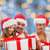 happy family in santa hats sitting with gift boxes stock photo © dolgachov