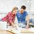smiling couple smearing wallpaper with glue stock photo © dolgachov