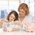 matka · córka · oszczędność · ceny · domu · nieruchomości - zdjęcia stock © dolgachov