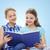 two happy girls reading book over blue background stock photo © dolgachov