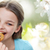 smiling little girl eating cookie or biscuit stock photo © dolgachov