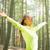 happy woman in sport clothes raising hands stock photo © dolgachov