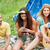 szczęśliwy · znajomych · napojów · gitara · kemping · podróży - zdjęcia stock © dolgachov