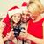 family in santa helper hats looking at pictires stock photo © dolgachov