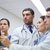 group of doctors looking at x ray scan image stock photo © dolgachov