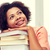 happy african student girl with books at home stock photo © dolgachov