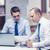 twee · zakenlieden · discussie · kantoor · papier · laptop - stockfoto © dolgachov