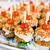 close up of canape hamburgers on serving tray stock photo © dolgachov
