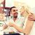 feliz · casal · potável · vinho · pôr · do · sol · rosa · vermelha - foto stock © dolgachov