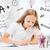 little student girl drawing at school stock photo © dolgachov