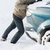 closeup of man pushing car stuck in snow stock photo © dolgachov