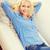 sonriendo · sofá · casa · felicidad · mujer - foto stock © dolgachov