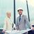 smiling businessmen with blueprint and helmets stock photo © dolgachov