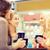 glimlachend · jonge · vrouwen · koffiekopjes · cafe · communicatie · vriendschap - stockfoto © dolgachov
