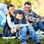 boldog · család · táblagép · sátor · tábor · helyszín · kempingezés - stock fotó © dolgachov