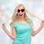 happy young woman in heart shape sunglasses stock photo © dolgachov