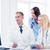 doctors looking at computer on meeting stock photo © dolgachov