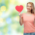 feliz · mulher · menina · adolescente · vermelho · forma · de · coração · amor - foto stock © dolgachov