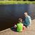 peu · garçon · canne · à · pêche · tige · séance · lac - photo stock © dolgachov
